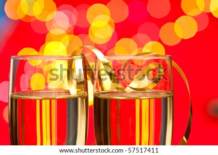 Two glasses of champagne with blured lights in background, very shallow DOF - stock photo