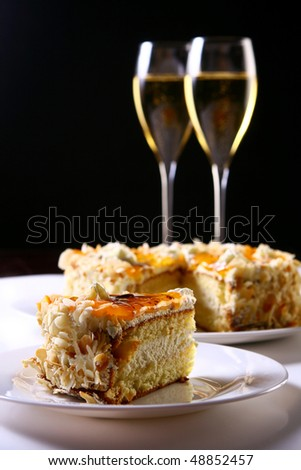two glasses of champagne with cakes - stock photo