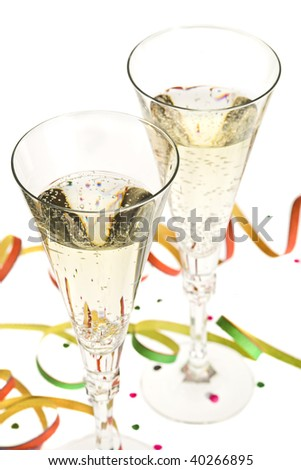 two glasses of champagne with new year's eve decoration, shallow depth of field