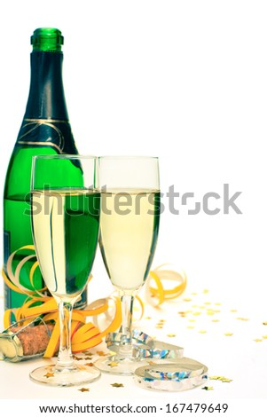 Two glasses of champagne with ribbons and confetti on white background - stock photo