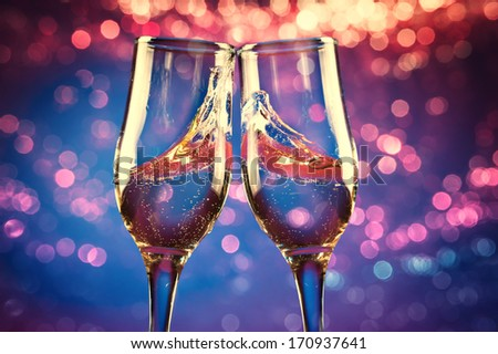 Two glasses of champagne with splash - stock photo
