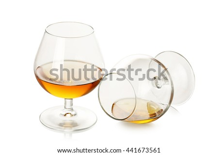 two glasses of cognac isolated on white - stock photo