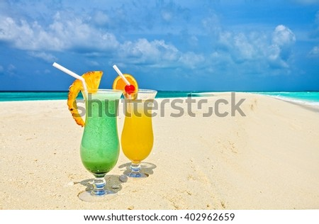 Two glasses of cool drink are on the beach, Maldives, The Indian Ocean - stock photo