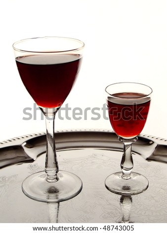 two glasses of cordial on silver tray - stock photo