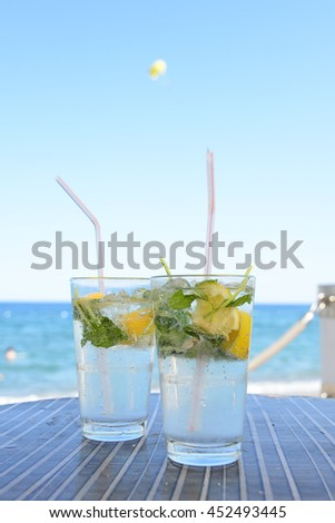 Two glasses of fresh Mojito on the beach cafe