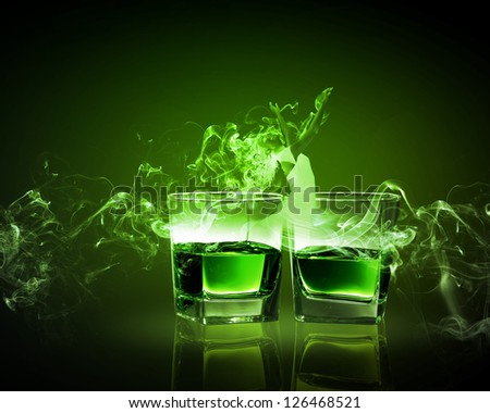 Two glasses of green absinth with fairy - stock photo