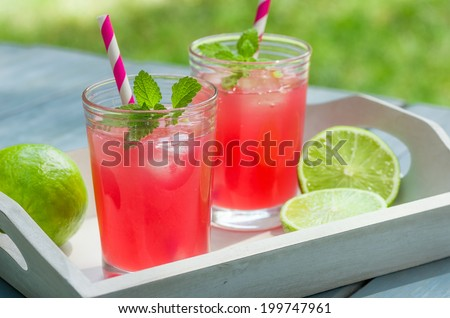Two glasses of ice cold lemonade - stock photo