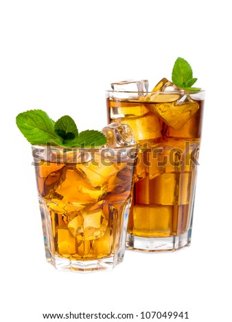 Two glasses of ice tea with mint - stock photo