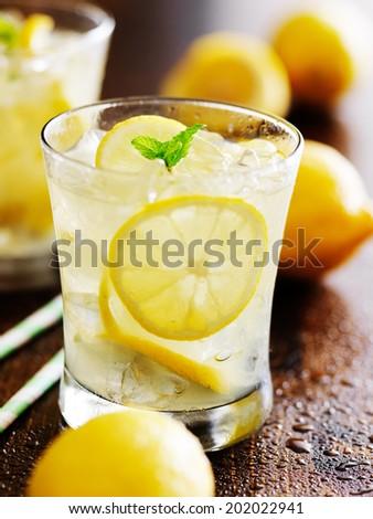 two glasses of lemonade shot close up - stock photo