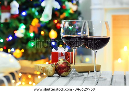 Two glasses of mulled wine on christmas decor background