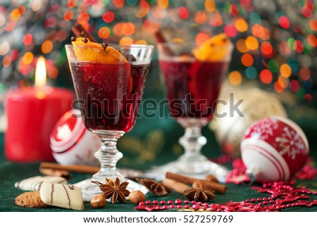 Two glasses of mulled wine with Christmas lights in the background