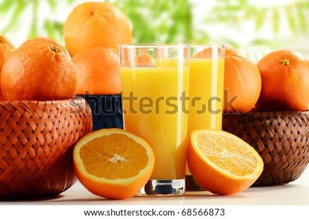 Two glasses of orange juice and fruits