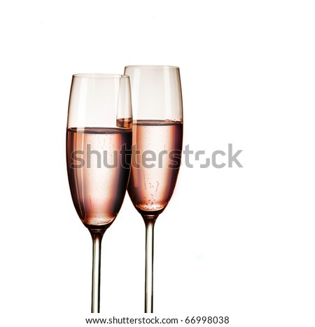 Two glasses of pink champagne, isolated on white background - stock photo