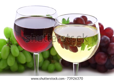Two glasses of red and white wine with grape reflection - stock photo