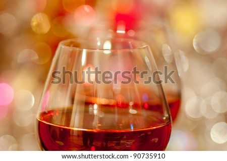 Two glasses of red wine and blurred background - stock photo
