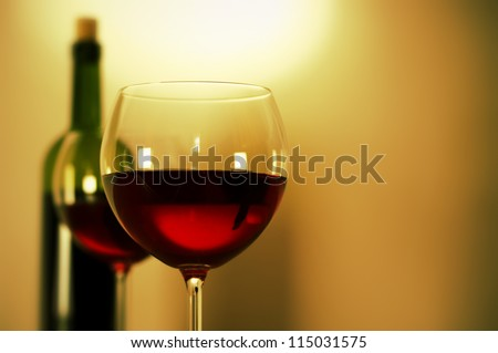Two glasses of red wine and wine bottle. - stock photo