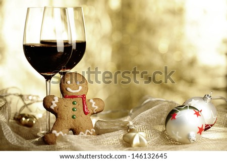Two glasses of Red Wine, Gingerbread Man and Christmas Ornaments - stock photo