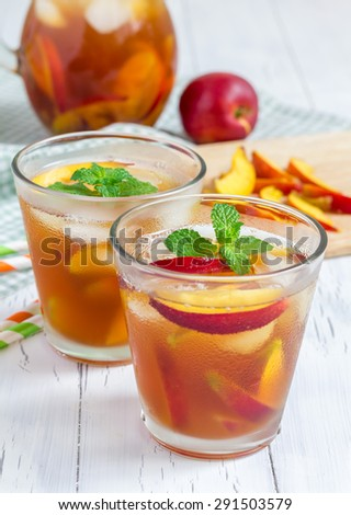 Two glasses of refreshing homemade nectarine iced tea - stock photo
