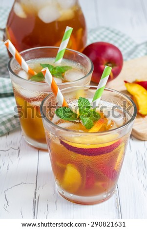 Two glasses of refreshing homemade peach iced tea - stock photo
