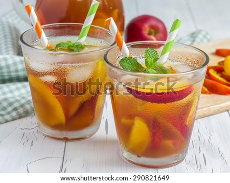 Two glasses of refreshing homemade peach iced tea