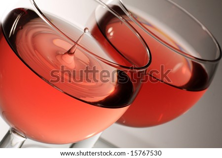 two glasses of rose wine with droplet - stock photo