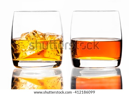 Two glasses of scotch whiskey and ice