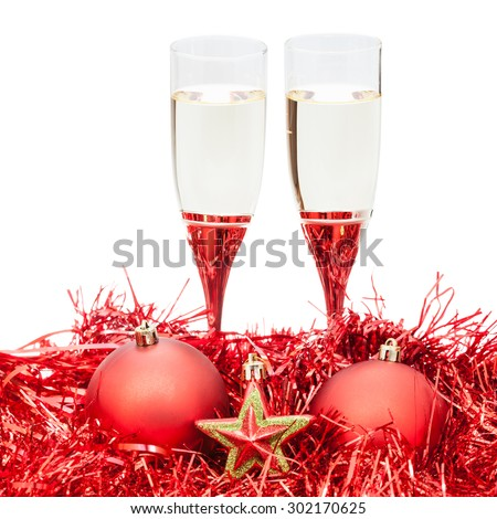 two glasses of sparkling wine and star at red Christmas decorations isolated on white background