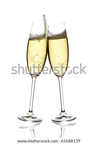 two glasses of sparkling wine, clinking, over white - stock photo