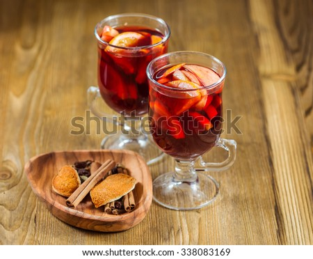 Two glasses of traditional mulled wine with spices. Shallow dof. - stock photo