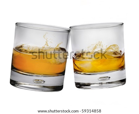 Two glasses of whiskey making a toast