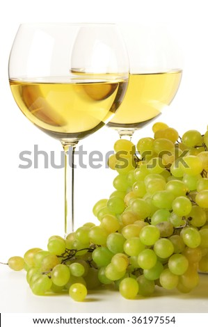 Two glasses of white wine and grape on white background. - stock photo