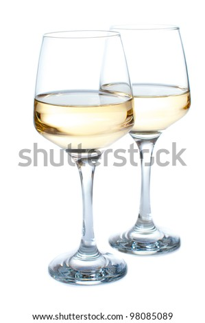 Two glasses of white wine on a white background - stock photo