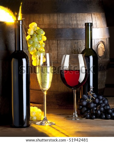 two glasses of wine and an old barrel - stock photo