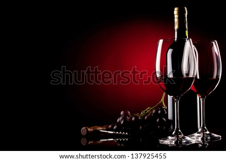 two glasses of wine, bottle, grapes and corkscrew - stock photo