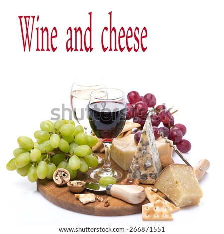 two glasses of wine, grapes and cheese assortment on a wooden board, isolated on white
