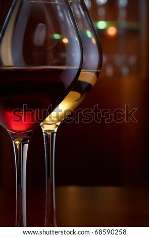 Two glasses of wine on the table in bar - stock photo