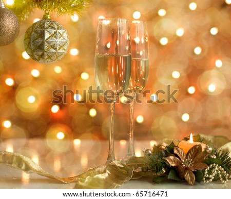 Two glasses of wine with a Christmas decor in the background. very shallow depth of field, focus on near glass. - stock photo