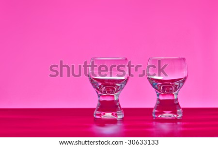 two glasses on the pink background