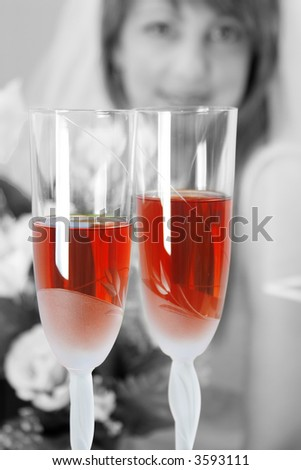 Two glasses with a wine and bride on background - stock photo