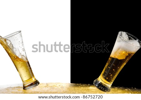Two glasses with beer on black and white background