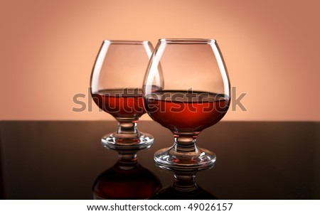 Two glasses with cognac on table