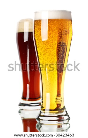 Two glasses with dark and light beer on a white background - stock photo