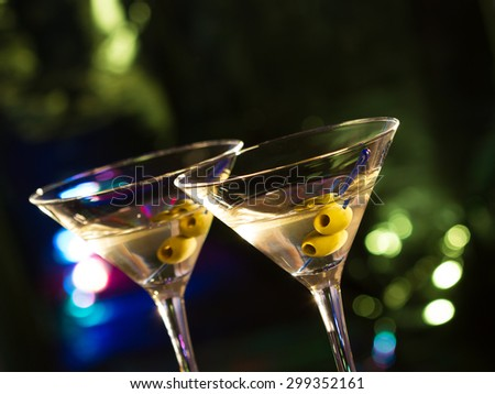 Two glasses with martini , focus on a olives - stock photo