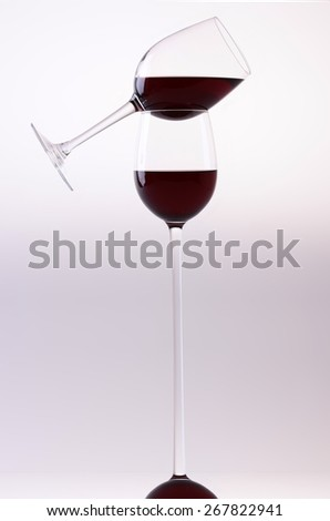 Two glasses with red wine on light background - stock photo