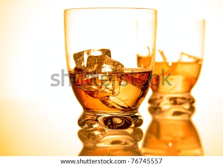 Two glasses with rum and ice - stock photo