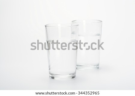 Two glasses with water on white background