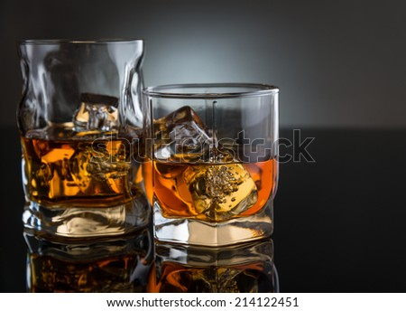 Two glasses with whisky - stock photo