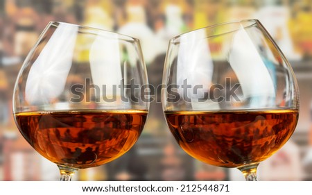 Two glasses with whisky on bar background - stock photo