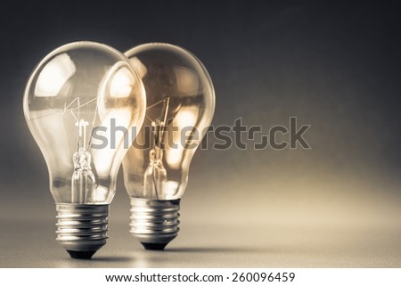Two glowing light bulbs - stock photo