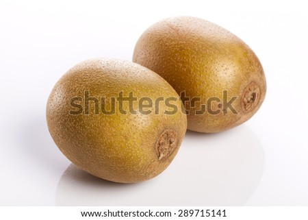 Two gold kiwi isolated white reflected at the studio. - stock photo